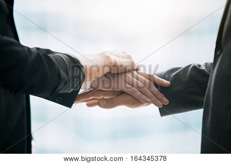 Close up of pile hands, people giving business solemn promise, start of new project, creating a strong partnership, business dealing with friends, individuals who share management and profits concept