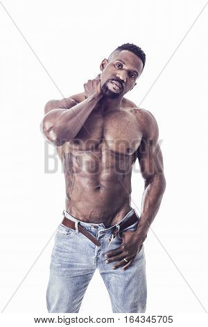 African American bodybuilder man, naked muscular torso, wearing jeans, isolated on white background