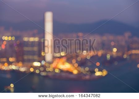 Aerial view blurred bokeh Hong Kong city over Victoria Bay abstract background