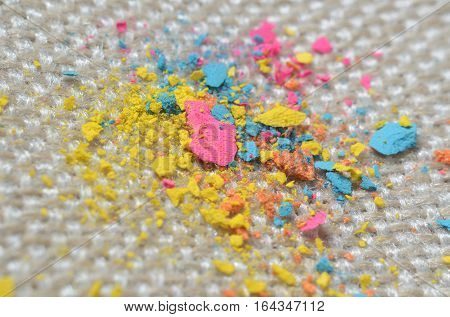 Close up picture of bright colorful powder on gunny textile. Concept photo for easy clean surfaces