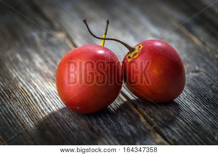 Fresh Fruit Tamarillo On Wooden Background