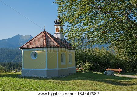 Pilgrimage Chapel And Bench In The Bavarian Alps