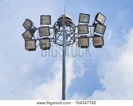 Spotlight lamp post on blue sky background