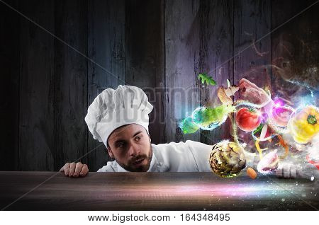 Chef looks enchanted the ingredients of a recipe that hover on the table