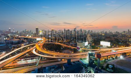 Bangkok city central business background and highway intersection with beautiful after sunset sky background Thailand