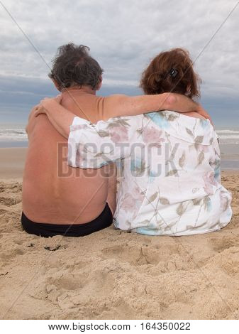 A Couple Of Senior Lovers On Vacation On The Beach