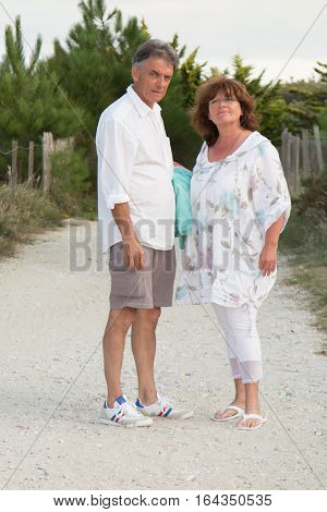 Senior Couple On Leave And Retirement On The Way To The Beach