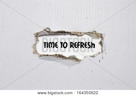 The word time to refresh appearing behind torn white paper cardboard.