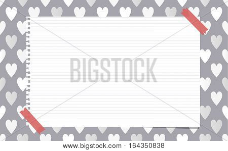 White ruled notebook, copybook, note paper stuck on pattern created of heart shapes.