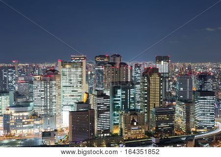 Night lights Osaka city business downtown view from Umeda Sky Building Japan