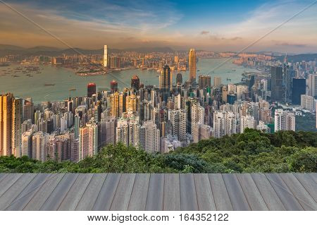 Opeing wooden floor Hong Kong city aerial view skyline over Victoria Bay