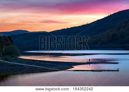 Fishing at Ladybower Reservoir in the Peak District National Park in the evening.