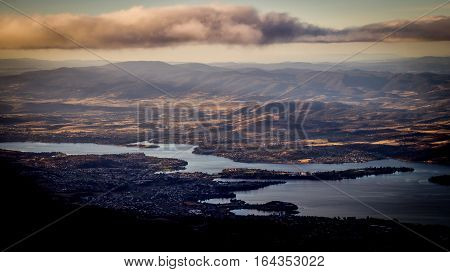 View from Mount Wellington overlooking the city of Hobart, Tasmania, Australia with clouds in afternoon light