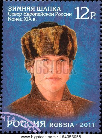 RUSSIA - CIRCA 2011: Stamp printed in Russia, shows the a man in a headdress of the Russian North, winter hat. End the XIX century