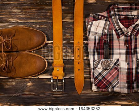 Men's brown clothing and accessories set: boots, leather belt and