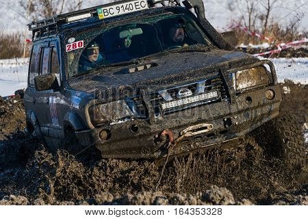 Lviv Ukraine - December 04 2016: Off-road vehicle brand Nissan overcomes the track on a amateur competitions Trial near the city Lviv Ukraine