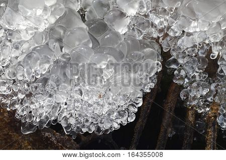 Frozen Water Fountain. Icicle Close Up. Winter Background