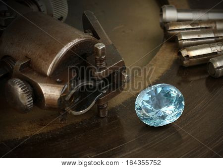 Faceting gemston big diamond with jewelery equipment. Jewellery manufacture.