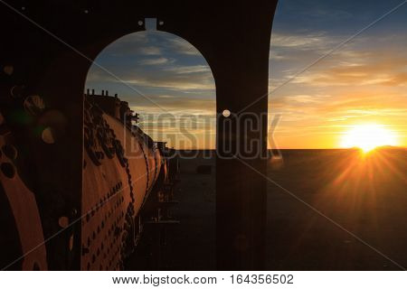 Ancient train cemetery at sunset Uyuni Altiplano Bolivia