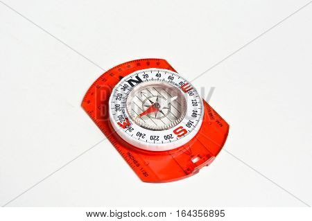 Compass on white. Magnetic navigation tool for orienteering.