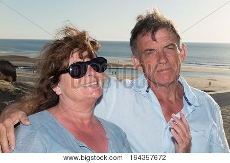 A Man And A Woman In A Retired Couple At The Seaside In The Evening