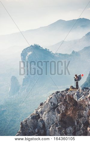 Traveler backpacker on mountains cliff hiking enjoy landscape Travel Lifestyle concept adventure active vacations outdoor aerial view