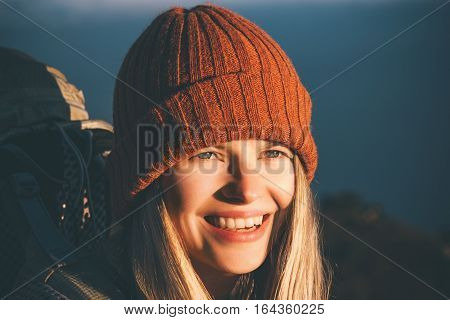Happy Woman smiling face traveler with backpack and hat Travel Lifestyle authentic emotions concept adventure vacations outdoor