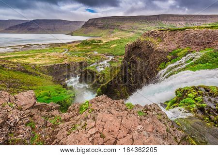 Mountain River Flowing Into The Lake Between The Mountains, Iceland