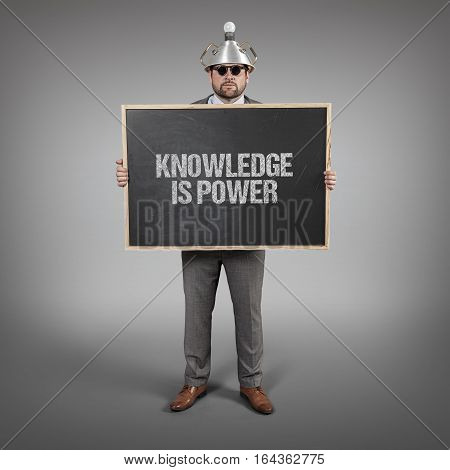 knowledge is power text on blackboard with science businessman holding blackboard sign