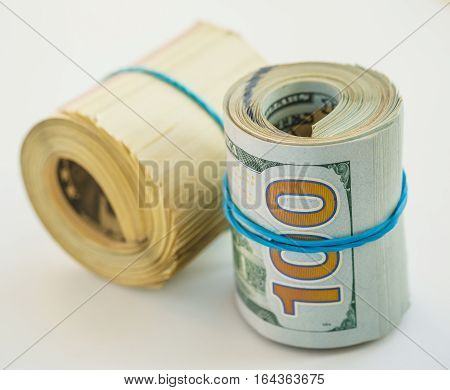Roll of hundred dollars, success or financial concept