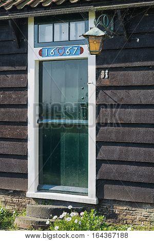 Zaanstad, Netherlands, September 3, 2014: antique door of an old house on the Zaanse Schans.
