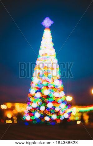 Defocused Blue Bokeh Background Effect. Design Backdrop. New Year Boke Lights Xmas Christmas Tree And Festive Illumination