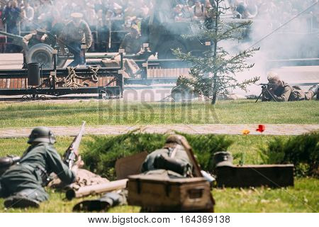 Gomel, Belarus - May 9, 2016: The Scene Of Historical Reenactment Of The Battle Of WW2 Between Reenactors Of Wehrmacht And Soviet Armed Forces On Celebrating Victory Day 9 May.