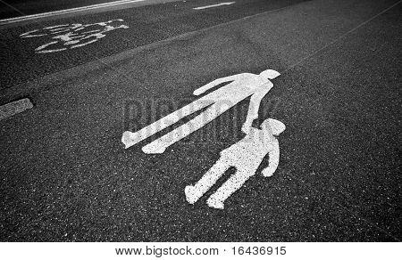 parental guidance concept - pedestrian sign on the  pavement/sidewalk