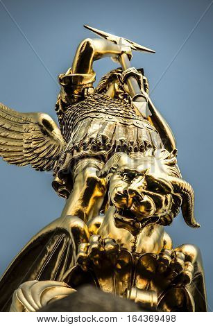 Archangel Michael fighting the dragon from the tower of the church in the town of Saint-Michel-Mont-Mercure France