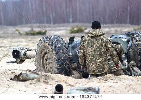 Heavy artillery gun on military at war