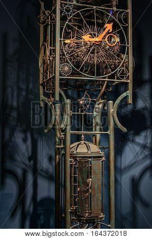 Spotlight clock system with metallic bars. Beautiful image with huge metallic clock mechanism and its shadow behind.