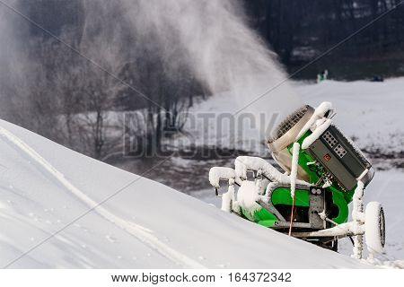 Working Snow Cannon At Ski Resort.