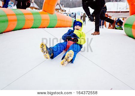 Child Having Fun On Snow