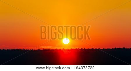 Panorama. Sun Over Horizon, Sunset, Sunrise Background. Sunset Over Dark Ground Forest. Panorama