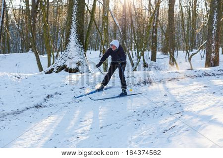 GRODNO, BELARUS - JAN 06: Amateur skier moves down the hill in a snowy forest at January 06, 2017 in Grodno, Belarus