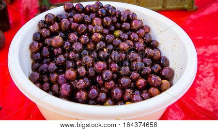Bowl of fresh cranberries at a market in Croatia