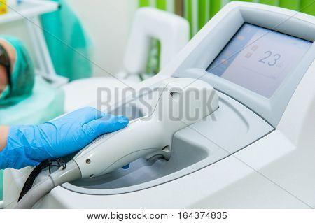 Beautician Specialist Adjusts Laser Equipment For Cosmetic Procedures In Cosmeticians Office, Close