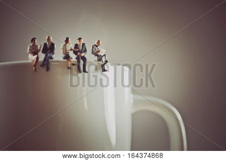 Office workers having a coffee break. Macro photo