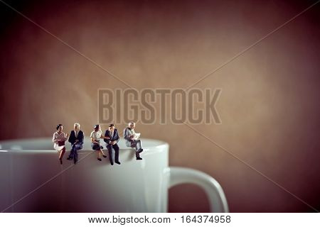 Business colleagues on coffee break. Macro photo