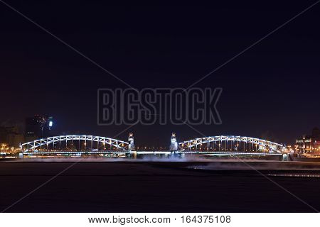 Showplace of Saint-Petersburg. Piter the great bridge in winter night. Tourist place.