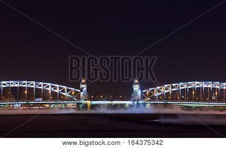 Piter the great bridge in the New Year lights in dark winter night, Saint-Petersburg.