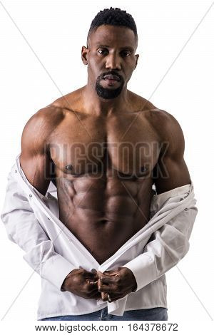 African American bodybuilder man, wearing jeans and open shirt on naked muscular torso, isolated on white background