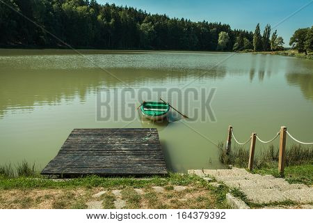 Boat In The Lake Near The Forest Ready For Fishing