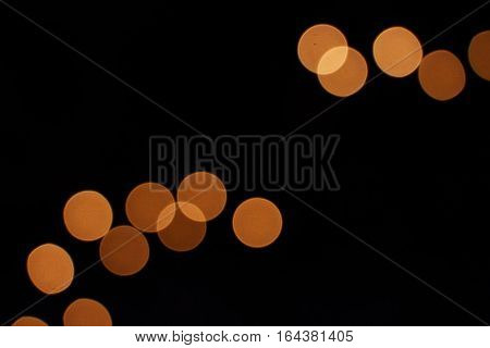 Spotted background of group of orange circles on black